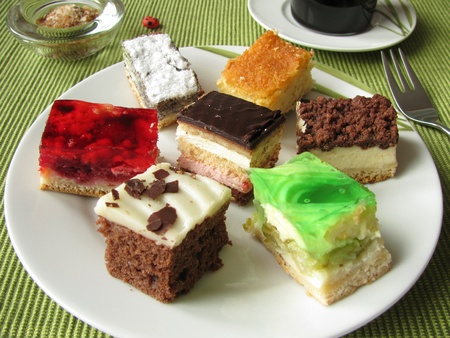 Small pieces of cakes on a plate photo