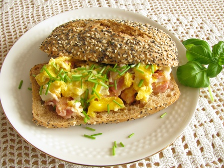 scrambled: Roll with scrambled eggs and ham Stock Photo