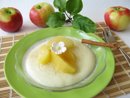 blancmange: Dessert with blancmange and stewed apples Stock Photo