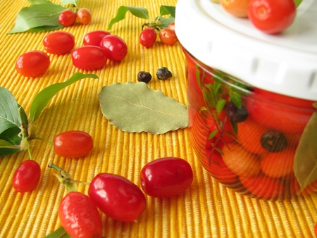 marinade: Cornelian cherries in vinegar marinade Stock Photo
