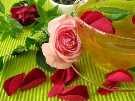 Green tea with rose flowers and lemon verbena photo