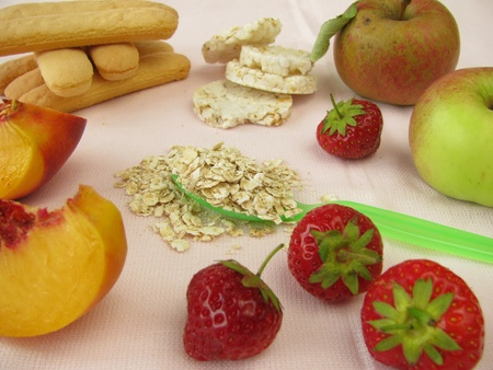 Small children diet with fruits, cookies and oat flakes photo