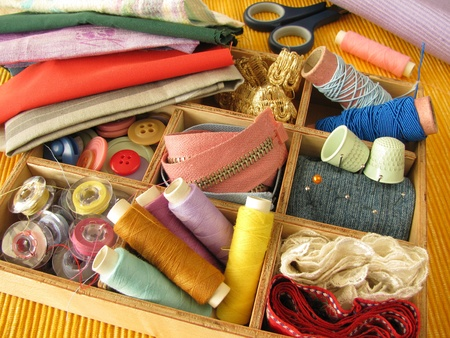 sewing box: Wooden box with colored sewing utensils