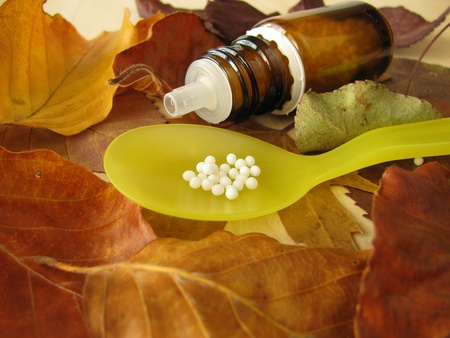 globuli: Fall leaves and homeopathic pills Stock Photo