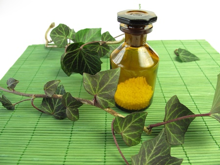 globuli: Homeopathic pills and ivy Stock Photo