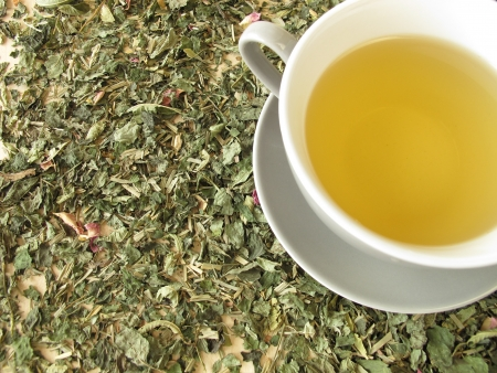 Cup of tea on herbs photo