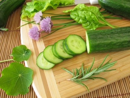 Preparation of cucumber salad with herbs Stock Photo