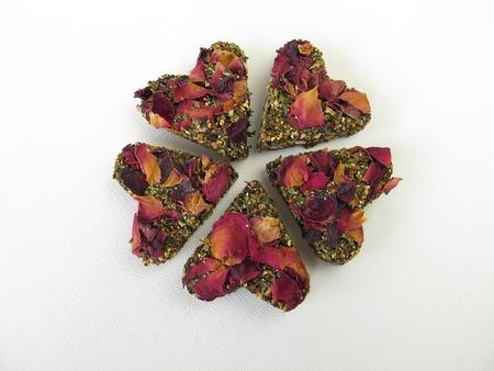 hart shaped: Shamrock made of pressed tea hearts  Stock Photo
