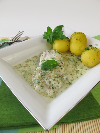 alaska pollock: Fish on herb sauce with potatoes