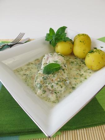 alaska pollock: Fish on herb sauce with potatoes