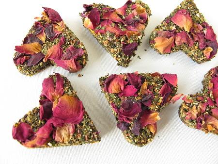hart shaped: Tea bricks made of pressed green tea and rose petals  Stock Photo