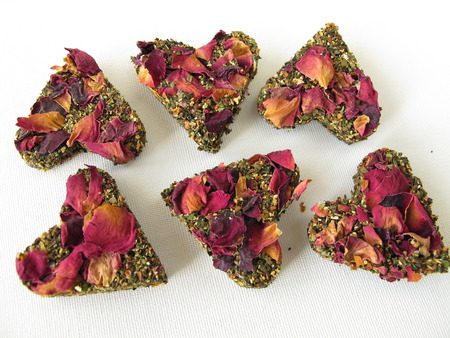 Tea bricks made of pressed green tea and rose petals  Stock Photo