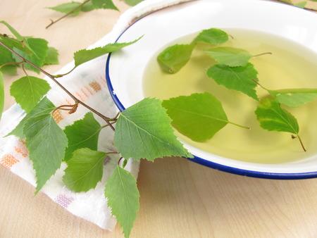 Bathing tea with birch leaves  Фото со стока