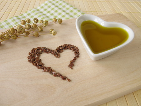 flaxseed: Heart made of linseed and flaxseed oil Stock Photo