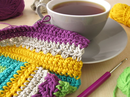 coziness: Crochet work and a cup of coffee Stock Photo