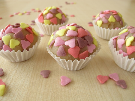 pralines: Marzipan pralines with sugar hearts