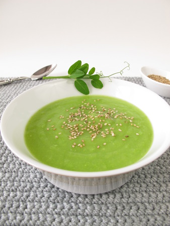 roasted sesame: Pea soup with roasted sesame and pea shoots Stock Photo