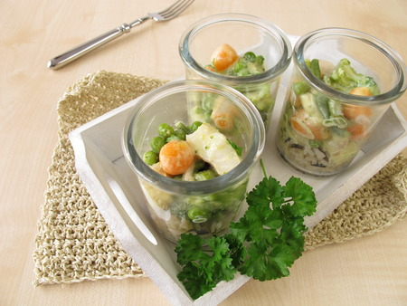 alaska pollock: Fish and vegetables on rice in glasses Stock Photo