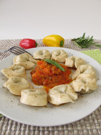bellpepper: Tortelloni with sweet pepper sauce Stock Photo