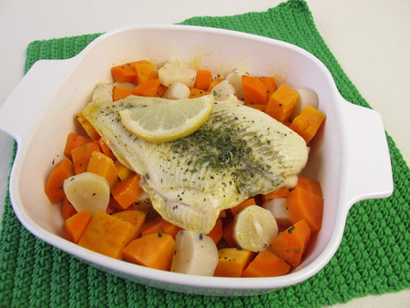 plaice: Steamed plaice on vegetables in cooking pot Stock Photo