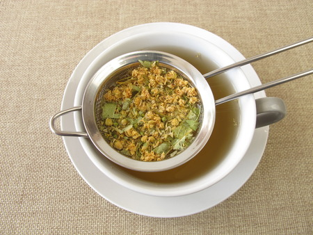 Tilia flowers tea in tea strainer