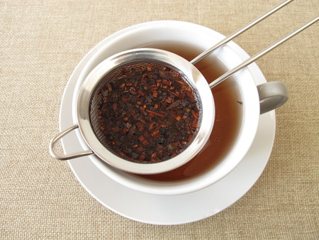 Honey bush tea in tea strainer