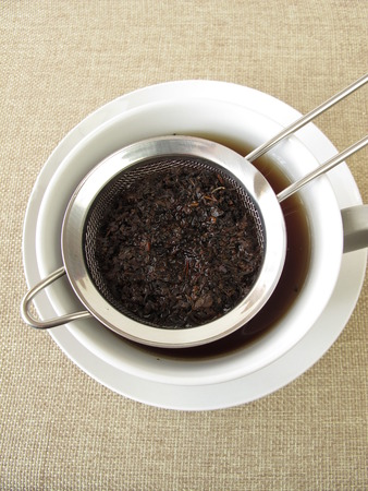 Black tea in tea strainer