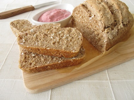 whole grain: Whole grain bread with vegetable spread from beetroot and horseradish Stock Photo