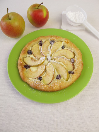 powdered: Apple pizza with raisins and powdered sugar