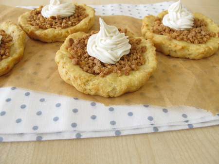 withe: Almond tartlets withe cake cream Stock Photo