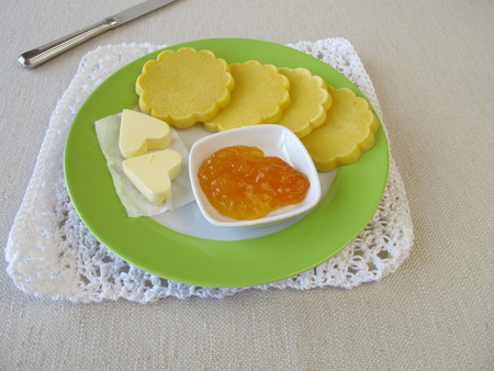 maize flour: Oven baked glutenfree maize pancakes with butter and jam Stock Photo