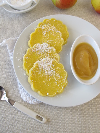 maize: Oven baked glutenfree maize pancakes with applesauce Stock Photo