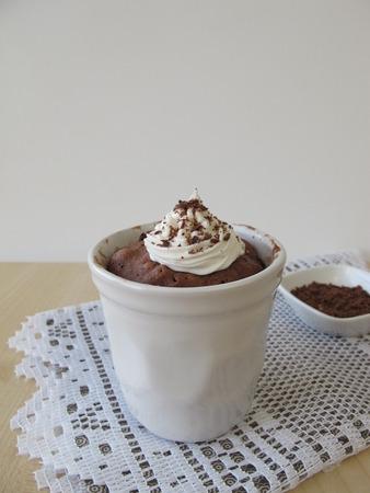 chocolate sprinkles: Nougat mug cake with sugar cream and chocolate sprinkles Stock Photo