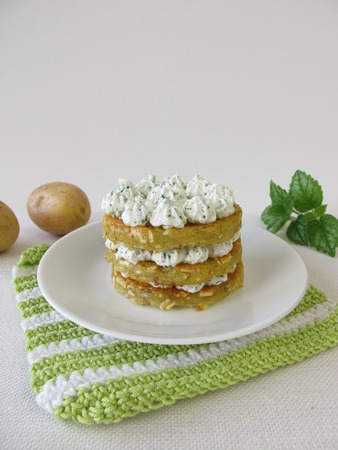 Layered potato pancakes with cream cheese
