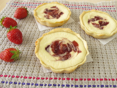 jam tarts: Small curd cheese cakes with strawberry jam