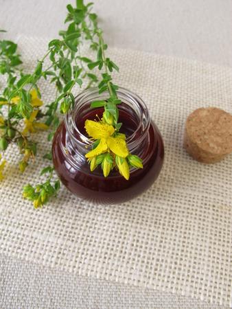 naturopathy: St. Johns wort oil in bottle