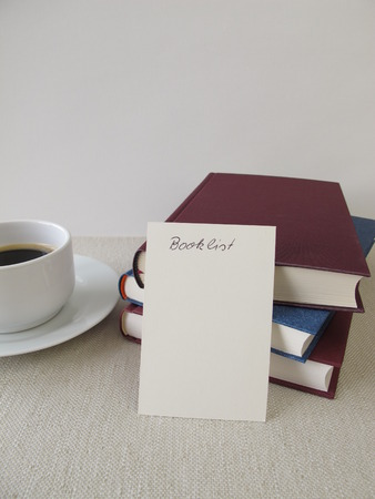 reading material: Books, blank booklist and cup of coffee Stock Photo