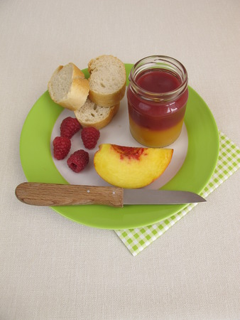 melba: Breakfast with bicolor peach and raspberry jam