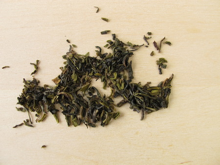 darjeeling: Darjeeling green tea on wooden background