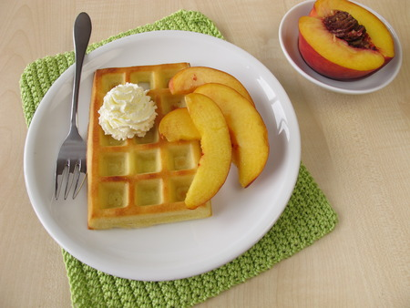 ovenbaked: Oven-baked belgian waffles with peaches and whipped cream