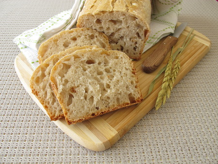 Sliced white bread with spelt flour from baking tin Stock Photo