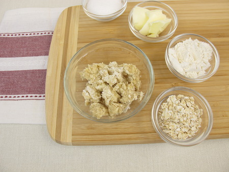 topping: Ingredients for preparation of crumble topping Stock Photo