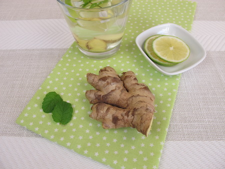 ginger root: Flavored water - Agua fresca with ginger root, lemon and mint Stock Photo