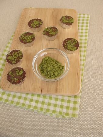 pralines: Homemade chocolate pralines with matcha Stock Photo