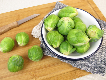 brussels: Brussels sprout in bowl on wooden board