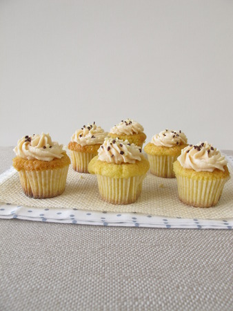 chocolate sprinkles: Gluten free cupcakes with fresh cheese cream and chocolate sprinkles Stock Photo