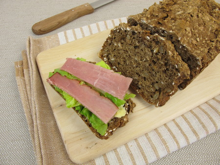 black bread: Black bread sandwich with ham and lettuce leaf