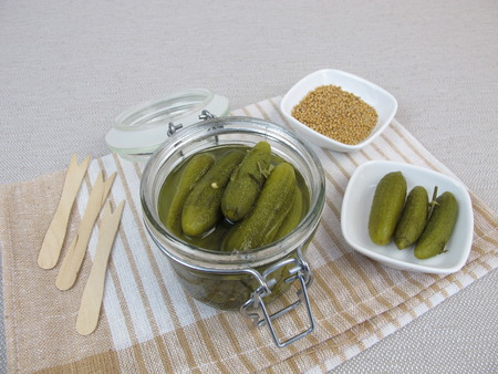 marinated gherkins: Pickled cucumber in jar Stock Photo