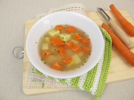 broth: Broth with potatoes and carrots Stock Photo