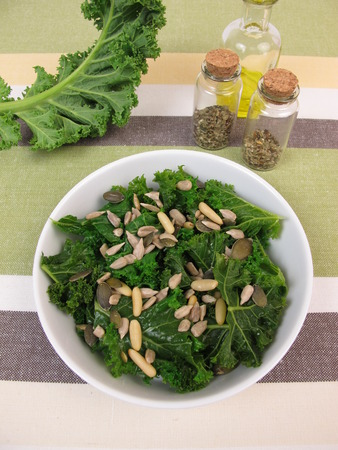 pine nuts: Kale salad with sunflower seeds, pine nuts, pumpkin seeds Stock Photo